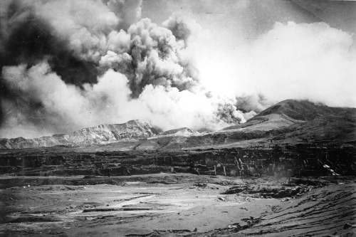 ST. PIERRE, MARTINIQUE -  MAY 10:  The city of St. Pierre lies in ruins after the eruption of the Mount Pelee volcano (in the background) in which 30,000 people were killed and only 2 survived 2 days after the eruption on May 10, 1902 at St. Pierre, Martinique. (Photo by Archive Farms/Getty Images)